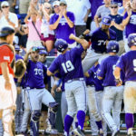 Teammates celebrate withTCU's Luken Baker (19) at the dugout after he hit a three-run home run against Texas Tech during the ninth inning of an NCAA men's College World Series baseball game in Omaha, Neb., Sunday, June 19, 2016. TCU won 5-3. (AP Photo/Nati Harnik)